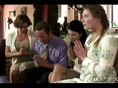 Religious family demonstrate their faith to a lucky businessman